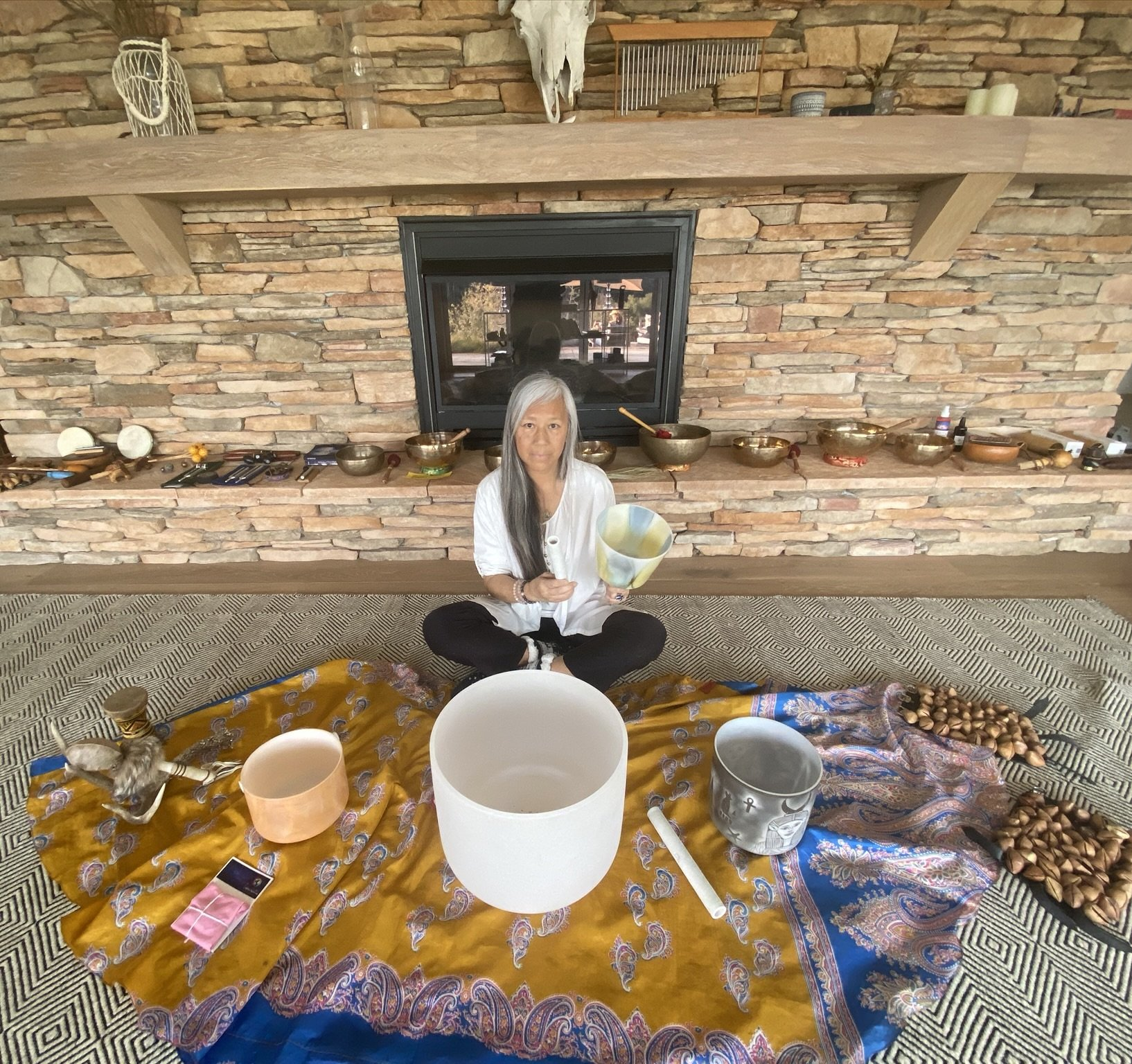 woman with sound bowls
