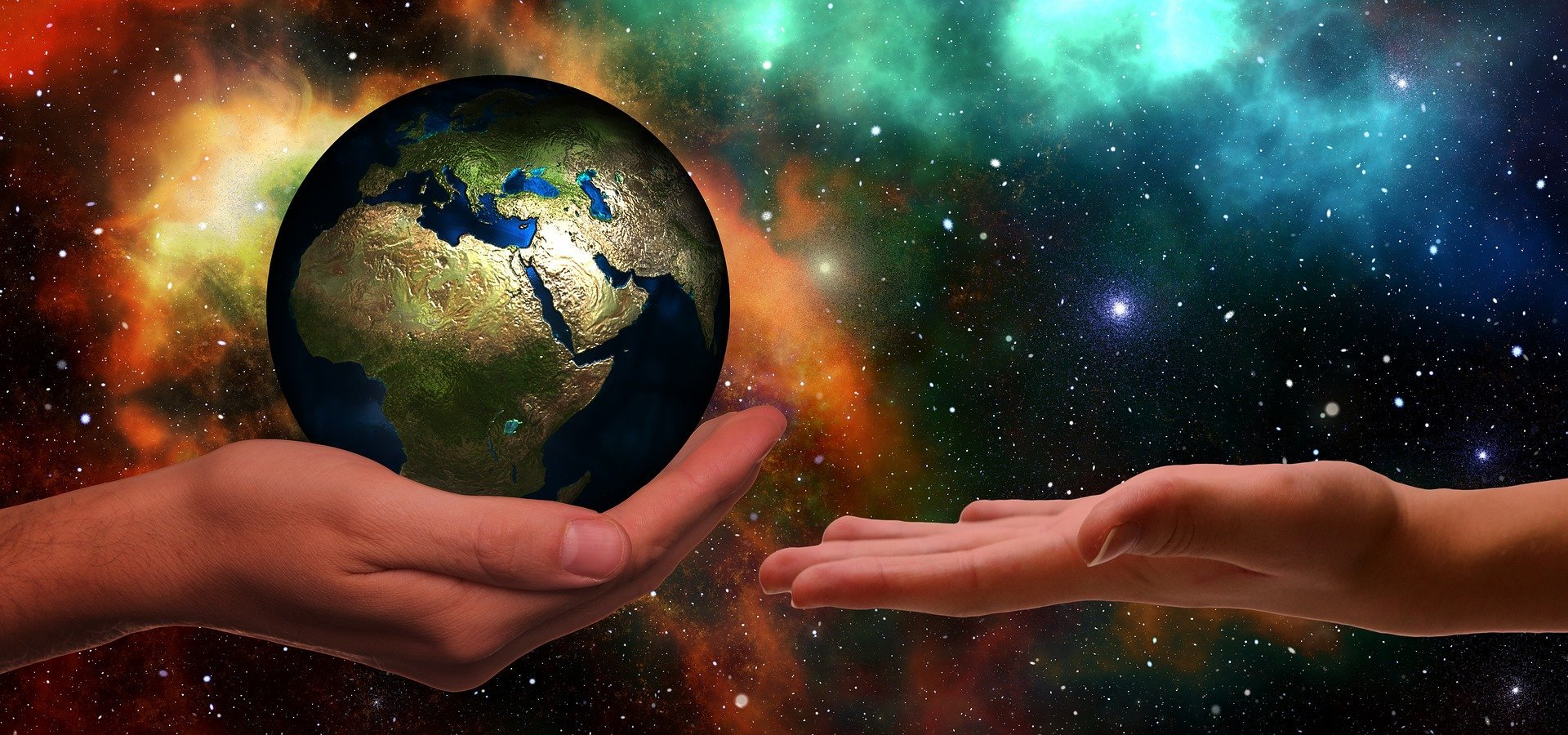 Hands passing the earth